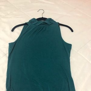 A gently used turtleneck neck sleeveless top